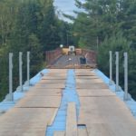 Decking removed on half the bridge.