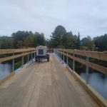 First layer of decking installed on half the bridge